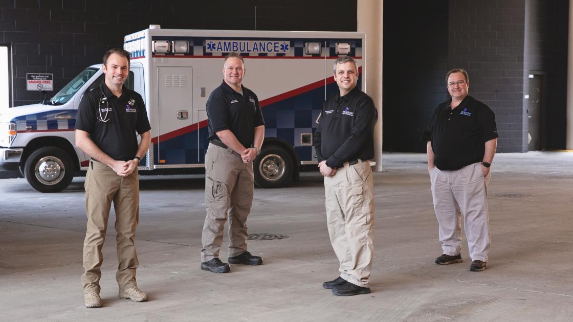 Emergency Medicine Team In Front of Ambulance