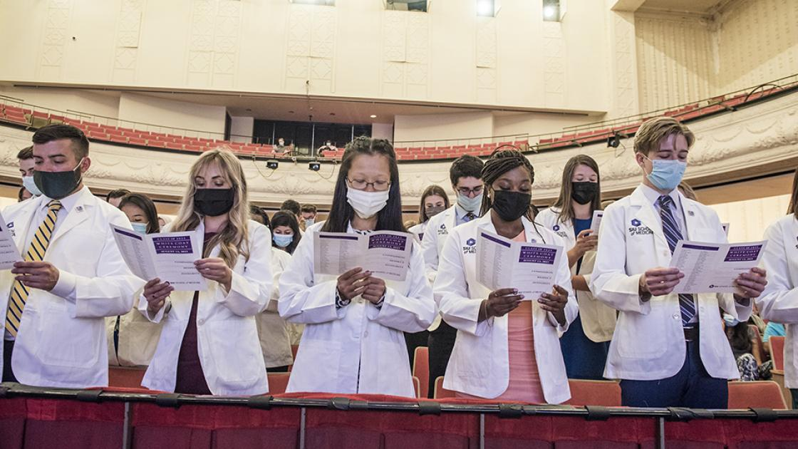 Students reciting the physician's pledge