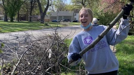 Medical Student Raking Leaves at Student Day of Service